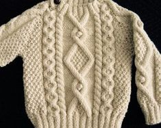 Irlandais aran laine kleinkind pullover design b etsy. Pullover Design, Sweater Design, Hand Knitted Sweaters, Baby Sweaters, Cable Knitting Patterns, Baby Boy Knitting, Toddler Sweater, Vintage Knitting, Etsy