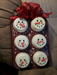 My snowmen...an old, funky junk store muffin tin transformed into a snowman party!