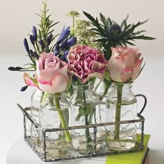 Six Vintage Style Glass Bottles With Flowers