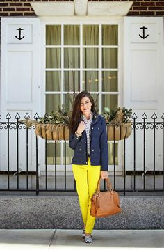 Bright yellow pants, stripes, navy military jacket