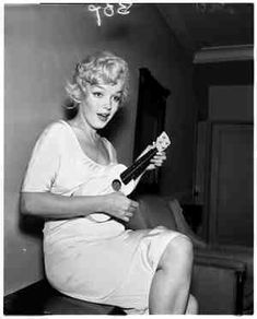 marilyn monroe played the ukulele... Oh my gosh I love her so much more now!!!