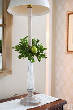 Christmas Decorating Idea for Lamps with faux greenery wrapped around the stick and an ornament wired onto the base; add real greenery to form the wreath Christmas Room, Christmas Mantels, Christmas Holidays, Christmas Crafts, Christmas Ideas, Merry Christmas, Front Door Christmas Decorations, Christmas Front Doors, Christmas Centerpieces