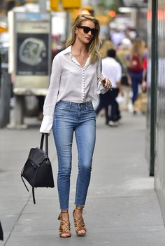 Pin for Later: Gigi Hadid Isn't the Only Supermodel Who Walks Down the Street Like She's on Set Rosie Huntington-Whiteley Styling a feminine button-down with blue skinny jeans and strappy heels.
