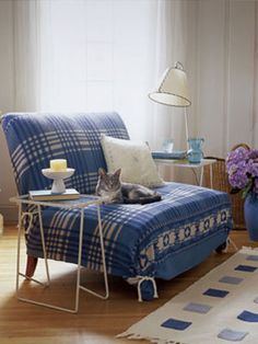 Woman's Day: Vintage Looks for your Home - A patterned blanket placed over sofas can make antique furniture even cozier.