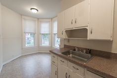 An upstairs kitchen with a view of downtown below Stone Mansion, Washington Street, Renting A House, Kitchen Cabinets, Mansions, Building, Home Decor, Decoration Home, Manor Houses