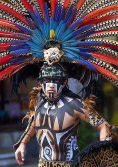 A man wearing a pre-Hispanic costume performs at a tourist area of Playa del Carmen in Quintana Roo state, Mexico, during preparations for the celebration of the end of the Maya Long Count Calendar - Baktun 13 - and the beginning of a new era  Picture: Pedro PARDO/AFP/Getty Images