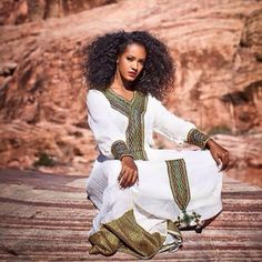 Habesha dress. Hand woven cotton. It takes five weeks to prepare the fabric and hand embroider it.