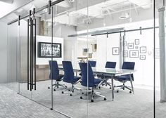 OFS designed their glass-walled conference rooms to have two wide entries. The Ragnar sliding door hardware means the space won't affect room flow and can easily be configured to fit the current need. Office Interior Design, Office Interiors, Home Interior, Showroom Design, Ragnar, Conference Room Design, Conference Table, Glass Curtain Wall, Glass Office
