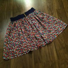 """Ditsy floral skirt Fluffy, fully lined Forever 21 skirt in a colorful ditsy floral print with a thick elastic waistband, faux belt, & tiered hem. Waist measures 23"""" unstretched. 16"""" long. EUC. No flaws of note. Forever 21 Skirts Mini"""