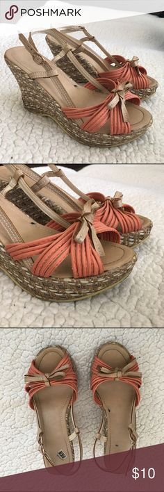 Wedge sandals Item: wedge sandals • Size: 37 in Euro sizing (translates to size 7) • Description: coral and tan straw wedge / gold hardware / bow accents • Condition: good, these were worn a couple times • Questions? Please ask / Offers considered Shoes Wedges