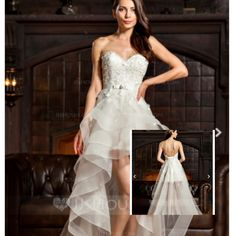 This is an a-line/princess sweetheart asymmetrical tulle lace wedding dress w/ beading bows for $196.99. Found on JJ's house.com. Hope you like
