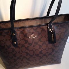"NWT Coach Signature Blk/Brn City Tote NWT Coach brown/black signature City Zip Top Tote. PVC coated canvas with black twill lining. Handles with 10"" drip. Inside black twill lining with zippered pocket and two slip pockets. F36876 No Trades Coach Bags Totes"