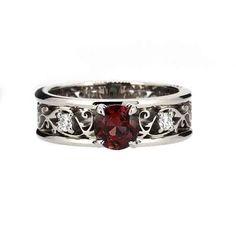 Wide filigree engagement ring with garnet and diamonds by TorkkeliJewellery