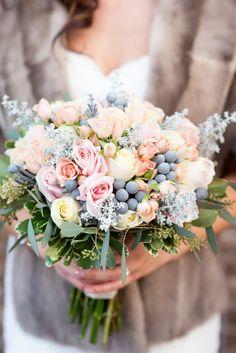 Hornbacher's Floral of Fargo, North Dakota, created thispastel bouquet of roses and hypericum berries