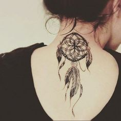 small dreamcatcher tattoo on back of neck: