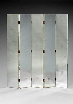 a pair of folding screen mirrors: 1933 Jacques Adnet. great for a small apartment to break up the space and make a small room seem open