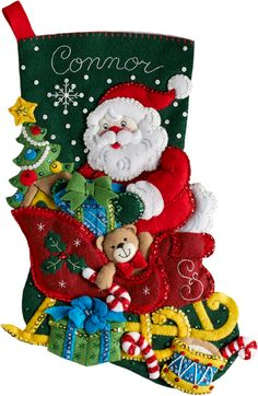 Santa fills his sleigh with toys in the Santa's sleigh felt Christmas stocking kit by Bucilla. Felt Stocking Kit, Christmas Stocking Kits, Felt Christmas Stockings, Christmas Ribbon, Vintage Christmas Ornaments, Christmas Wreaths, Christmas Crafts, Christmas Tree, White Christmas