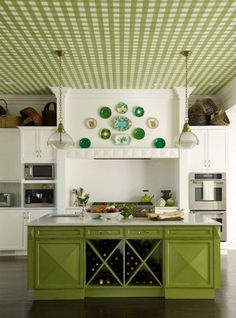 Kitchen Vintage Design Green Plate Decoration On The Wall White Granite Countertop Island Pendant Lamps Wooden Floor.jpg Awesome Decor