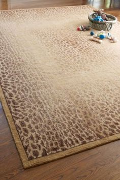 Our Vintage Panthera Rug has been expertly antiqued to create the impression of a lived-in look. Crafted of 100% New Zealand Wool.