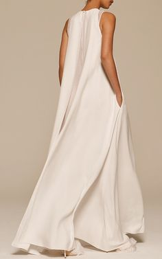 This **Adam Lippes** gown features a jewel neckline and an a-line silhouette.