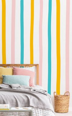 Style a playful space that features pops of stylish color with this Pastel Colorful Stripe Wallpaper Mural. Featuring fresh blue, orange and pink stripes on a paper texture backdrop, this fun hand drawn design has a rustic nature that makes it a great choice for kids' bedrooms or playrooms. The simple style of the design however means it's versatile enough to work in a range of spaces and themes, why not brighten up your office space, creating a positive energy.