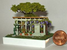 This beautiful greenhouse, lying in a meadow and shaded by a leafy tree, is completely handmade. Garden Accessories, Floating Shelves, Miniatures, Landscape, Flowers, Handmade, Etsy, Beautiful, Home Decor