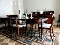 Dining room in Ben Pentreath's Dorset parsonage home.  The chairs are upholstered with a ticking fabric from Ian Mankin.