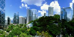Hong Kong park blends effortlessly into its surrounding cityscape, its flowing artistic design a talking point as much as the greenhouse, playgrounds and tropical aviary. Hong Kong Tourism Board, Destinations, Hongkong, Victoria Harbour, Asia, Urban Setting, World Cities, Park City, Seattle Skyline