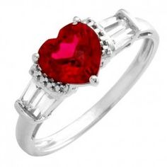 10K Gold Ring w Ruby Size 7  Material: 10K solid white gold  Gemstones: 1/1.53ct created ruby  Gemstones: 4/0.27ct created sapphire  Total Carat Weight: 1.80ct  Width in mm: 7.8mm  Width in inch: 1/4-inch  Stamped: 10k