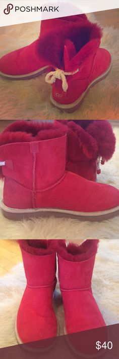UGG boots Short Red Uggs with a bow in the back. EUC UGG Shoes Ankle Boots & Booties