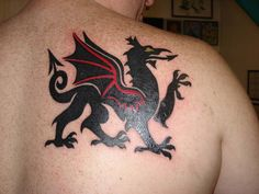 My husband's first tattoo.  Got this with his brother at the same time.  It's Welsh dragon to celebrate their Welsh heritage.