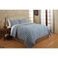 The Riker quilt set can be added to any bedroom for maximum comfort and style. Constructed of 100-percent cotton, the quilt features a striped pattern in a blue finish. Two shams are included to complete the look.