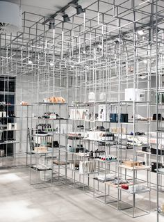 Raw galavanized steel boxes provides a cool and transparent look for Minimum at their Concept Store in Aarhus, Denmark