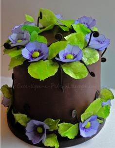 Purple Wafer Paper Flowers - Handpainted flowers with detailed edges, m center. Leaves are also wafer paper. Devils Food with espresso BC and dark chocolate ganache. Chocolate fondant fern coils.