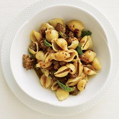 Pasta with Sausage, Basil and Mustard | British cookbook author Nigel Slater created this quick pasta supper with warm, mildly spicy flavors.