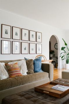 living room with gallery art and arched doorways