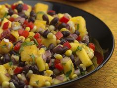 Roasted Corn, Black Bean & Mango Salad -- A fresh-tasting salad that adds delicious variety to grilled foods, such as salmon, halibut, chicken or pork. Bean Salad Recipes, Healthy Salad Recipes, Vegetarian Recipes, Cooking Recipes, Healthy Foods, Healthy Skin, Healthy Gourmet, Healthy Dinners, Delicious Recipes