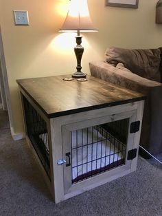 DIY Dog crate end table: break down an old wire crate with bolt cutters, build a. - DIY Dog crate end table: break down an old wire crate with bolt cutters, build a frame around it, m - Dog Crate End Table, Diy Dog Crate, Dog Kennel End Table, Wire Crate, Wire Dog Crates, Dog Crate Furniture, Furniture Ideas, Build A Frame, Dog Rooms