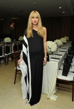 What baby bump, Rachel Zoe? OMG I LOVE THIS. I DEFINITELY NEED TO FIND THIS WHEN I GET PREGNANT. THIS IS A GOOD OUTFIT FOR A MAGNIFICENT MOTHER TO BE TO WEAR AT HER OWN SHOWER