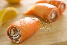 Smoked Salmon Pinwheel  For a savory snack under 60 calories, spread 1 tablespoon of low-fat cream cheese onto a slice of smoked salmon (lox) and roll it up. This salmon pinwheel is high in protein and heart-healthy omega-3 fatty acids, though the salt used to cure the salmon boosts the sodium content. Use a little less cream cheese and you can have two pinwheels for under 100 calories.  Saturated Fat: 1.6 g  Sodium: 495 mg  Cholesterol: 13 mg