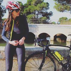 Women in tights... Women on bikes... — Taking a break by the river