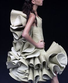 This is a three-dimensional fashion garment, I like this garment because the dramatic ruffles look magnificent. This garment only uses one technique but is still able to achieve a creative detailing.