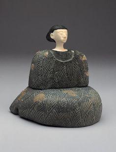 Seated Female Figure ProvenanceBactria PeriodLate 3rd - early 2nd millennium B.C. MaterialsChlorite and white limestone DimensionsH-12.4 D-9 W-12.1