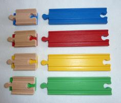 colored wooden train track and Duplo adapters www.facebook.com/woodpeckers.ch