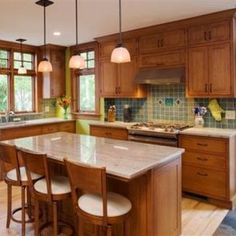 craftsman kitchen idea- layout of stove cabinets and windows