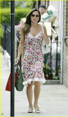 Kate Middleton is ready for summer, wearing a floral print dress while out and about in London on Thursday.