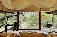 All eight suites at Sanctuary's Makanyane Lodge in South Africa's Madikwe Game Reserve have glass-walled bedrooms facing the Marico River.