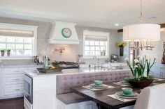 What had formerly been a dated and confining kitchen now feels airy, open and elegant. Integrating the bench seat with the island helped save space and creates an enhanced flow between the kitchen and dining area.