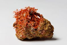 Crocoite     Crocoite is a mineral consisting of lead(II) chromate and crystallizing in a monoclinic crystal system, and it is the only chromate of any importance found in nature.