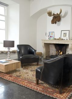 Leather Chairs…Fireplace